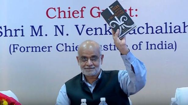 BD Mehta book launch showing book.JPG